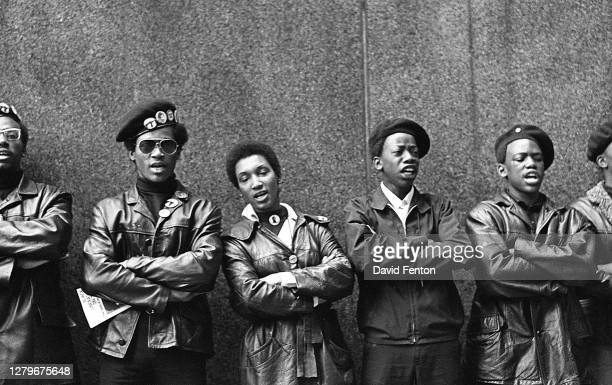 View of a line of Black Panther Party members as they demonstrate, arms folded, outside the New York County Criminal Court , New York, New York,...