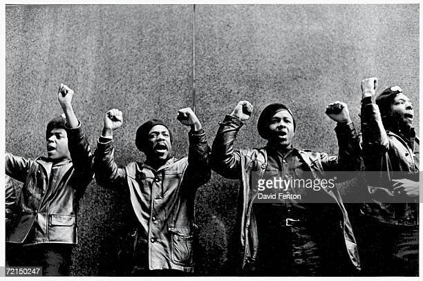 View of a line of Black Panther Party members as they demonstrate, fists, outside the New York County Criminal Court , New York, New York, April 11,...