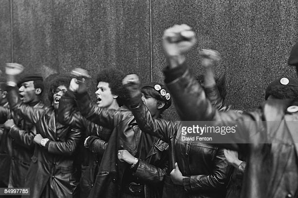 View of a line of Black Panther Party members as they demonstrate, fists raised, outside the New York County Criminal Court , New York, New York,...