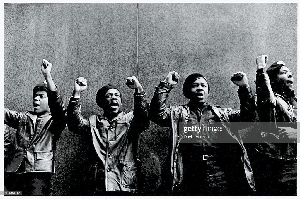 View of a line of Black Panther Party members as they stand outside the New York City courthouse under a portion of an Abraham Lincoln quote which reads 'The Ultimate Justice of the People,' New York, New York, April 11, 1969.