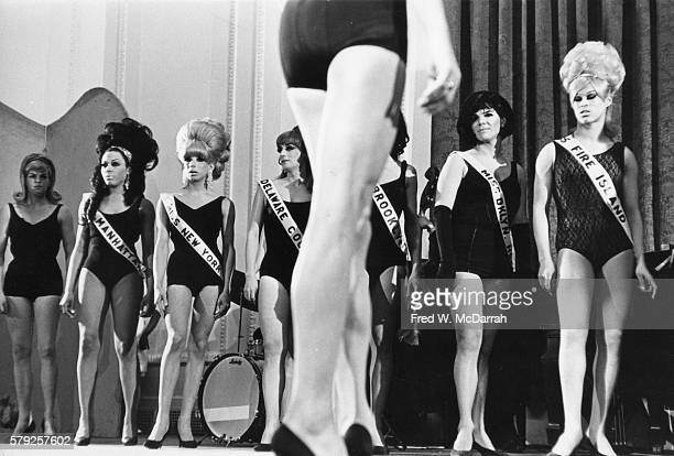 View of a line of drag performers onstage as they compete during a beauty contest New York New York February 20 1967 Among those pictured are Miss...