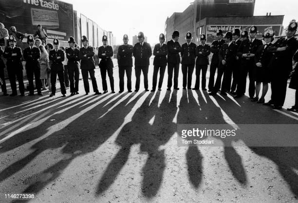 View of a line of police officers in East London's Brick Lane before a confrontation between National Front supporters and antiracist demonstrators...