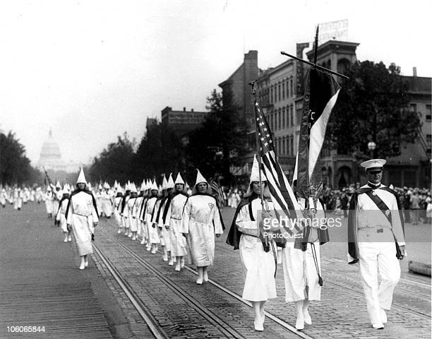 View of a line of women as they march in a Ku Klux Klan parade along Pennsylvania Avenue Washington DC 1928