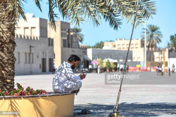 A view of a local man using his phone near a market in Dubai Old Town On Monday 6 February in Dubai UAE