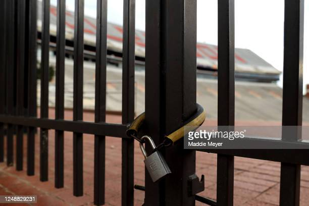 View of a locked gate outside of Clemson Memorial Stadium on the campus of Clemson University on June 10, 2020 in Clemson, South Carolina. The campus...
