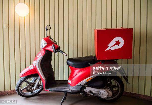 A view of a logo on a scooter in the reception area of the global headquarters of online food ordering and delivery giant Delivery Hero is pictured...