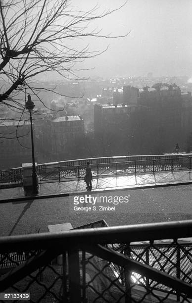 A view of a lone pedestrian as seen from the Sacre Coeur in Paris 1952
