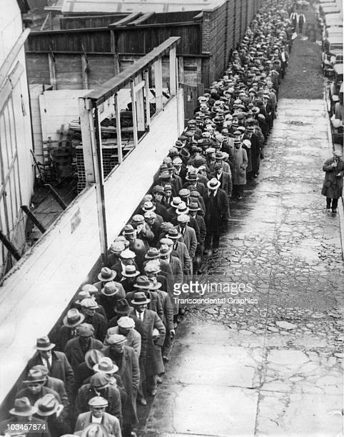 View of a long breadline for food set up during the Great Depression in New York City 1931