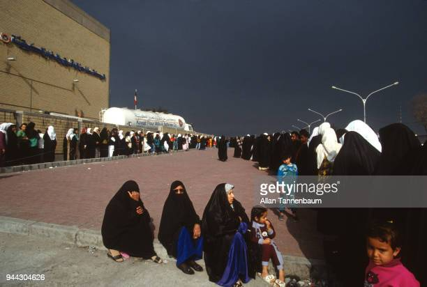 View of a long line of Palestinian women and children as they wait in a line for bread during the Gulf War Kuwait City Kuwait 1991