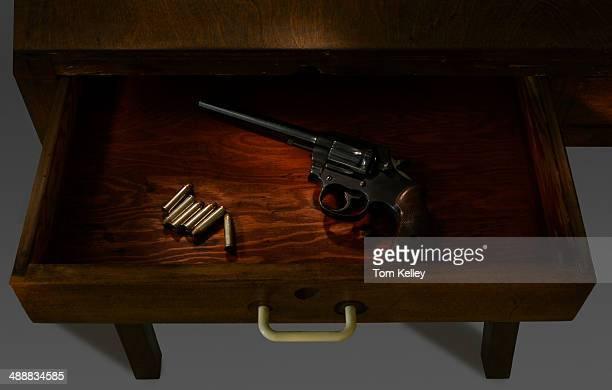 View of a longbarrelled revolver and six38 Special cartridges in a drawer 2013