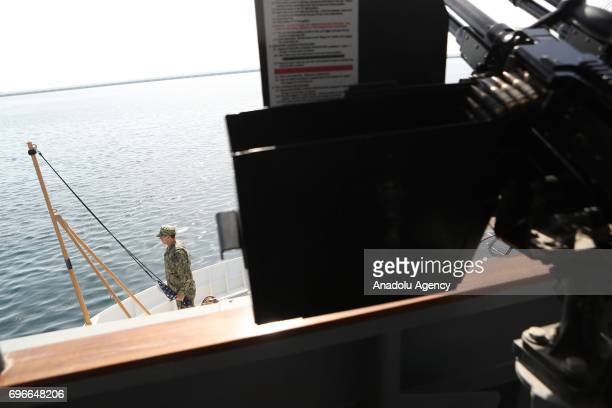 A view of a machine gun loaded ship at Hamad Port in Doha Qatar on June 16 2017 After 12 billion dollars worth F35 fighter jet agreement United...