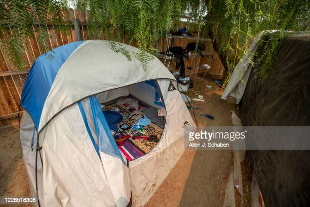 A view of a makeshift grow shelter tent and debris at the property where seven people were shot to death over Labor Day weekend at an illegal...