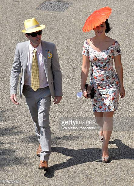 View of a male and female racegoer attending Ladies Day during the Glorious Goodwood Race of Champions Meeting at Goodwood racecourse in West Sussex...