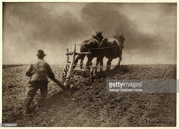 View of a man as he tills a field with the help of a horsedrawn plow England mid to late 1880s