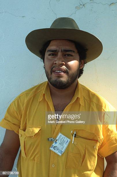 View of a man in a brown hat and yellow shirt, Juarez, Mexico, late 1980s.
