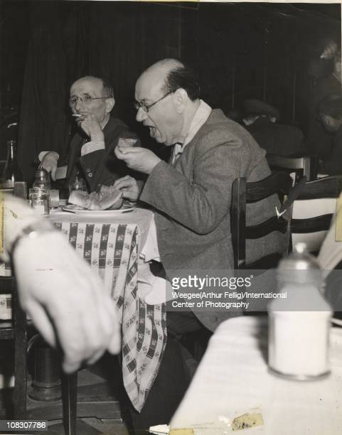 View of a man perhaps composer Joseph Rumshinsky eating watermelon at the Cafe Royal a meeting place for Yiddish actors on Second Avenue in the Lower...