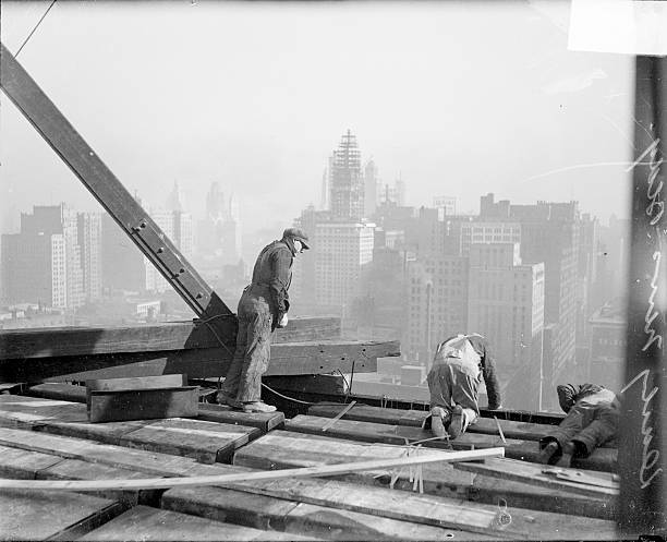 Workers Stand Atop A Construction Site