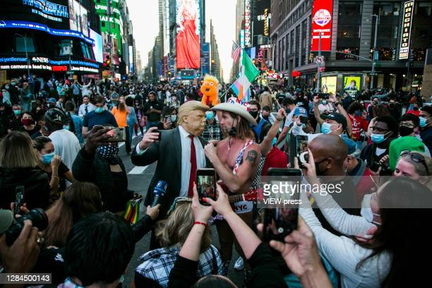 View of a man wearing a Donald Trump mask in Times Square after it was announced that Democratic candidate Joe Biden would be the next president of...