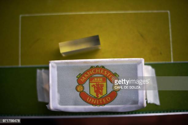 View of a Manchester United logo on the goal of a Button Football tabletop in Rio de Janeiro Brazil on May 19 2018 Every weekend some 20 to 30...