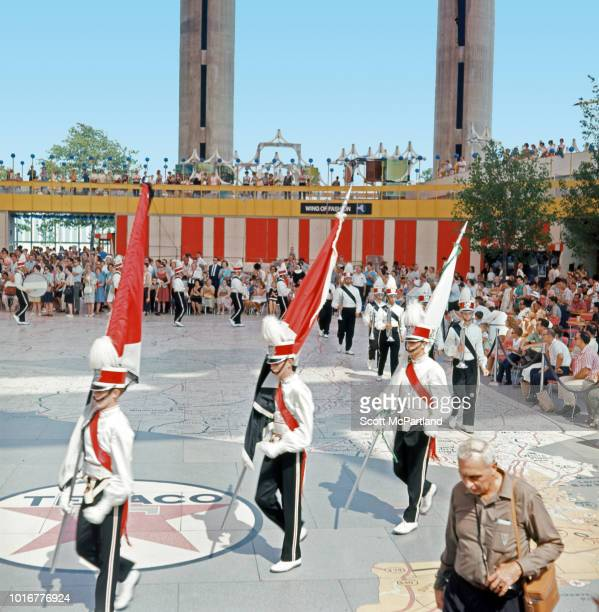 View of a marching band as they perform for a crowd in the New York State Pavilion during the World's Fair in Flushing Meadows Park Queens New York...