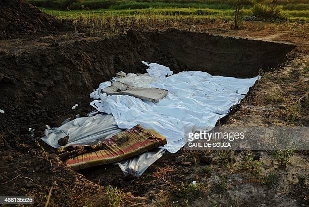 View of a mass grave near St Andrews church in Bor on January 31, 2014. Recent fighting in the country has seen waves of brutal revenge attacks, as...