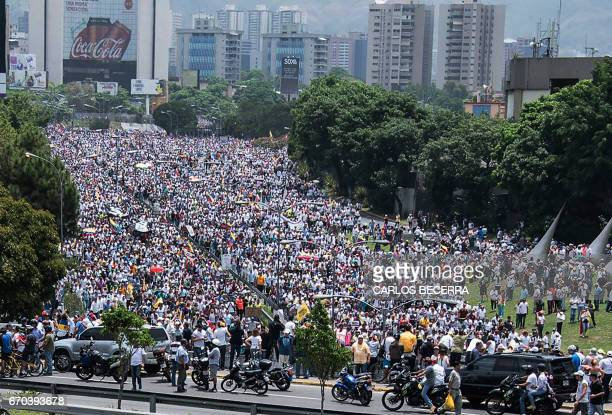 View of a mass march against Venezuelan President Nicolas Maduro in Caracas on April 19 2017 Venezuelans took to the streets Wednesday for massive...