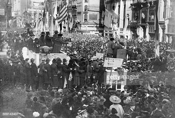 View of a massive crowd of people outside the New York Public Library to celebration Armistice Day New York New York 1918 Two visible signs read 'The...