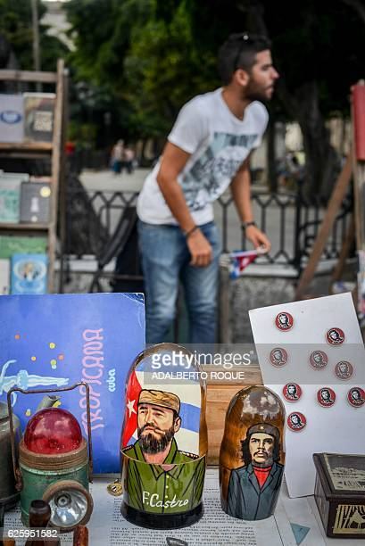 View of a matrioshka of Cuban revolutionary leader Fidel Castro displayed for sale in a street of Havana on November 26 the day after he died aged 90...