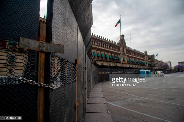 View of a metal fence surrounding the National Palace placed as a preventive measure against possible marches ahead of the International Women's Day...