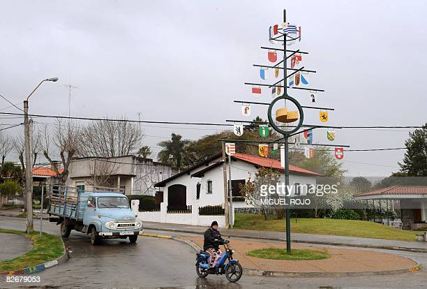 View of a metal tree displaying the Swiss, French and Uruguayan flags and the coat of arms of the many Swiss cantons on September 5, 2008 in Nueva...