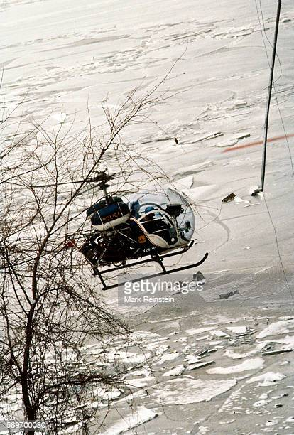 View of a Metropolitan Police Department of the District of Columbia helicopter as it hovers low over the surface of the Potomac River to aid in the...