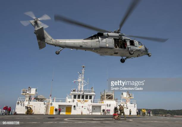 View of a MH-60S Sea Hawk helicopter during a humanitarian and disaster relief exercise aboard Military Sealift Command hospital ship USNS Mercy at...