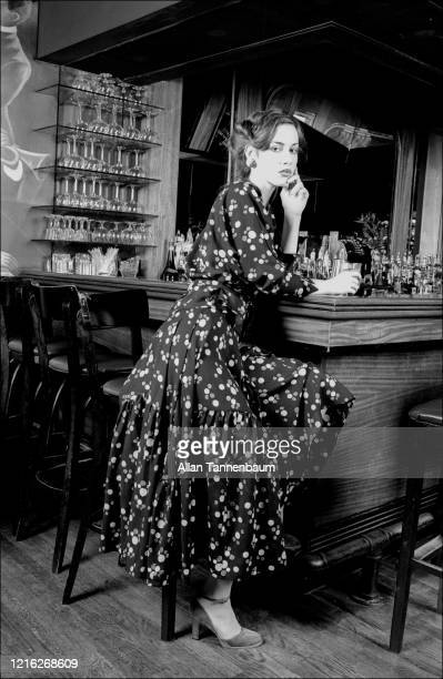 View of a model , dressed in clothing by Palma, as she sits at the bar in SoHo's WPA restaurant, New York, New York, December 8, 1978.
