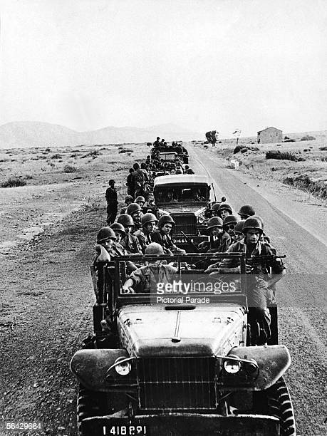 View of a motorcade of armed French Foreign Legion troops in service in Northern Algeria, 1950s.