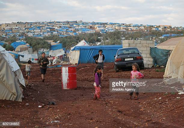 A view of a muddy ground tent city named Atme which is submerged due to the rain in Idlib Syria on November 1 2016 Syrian refugees flee from their...