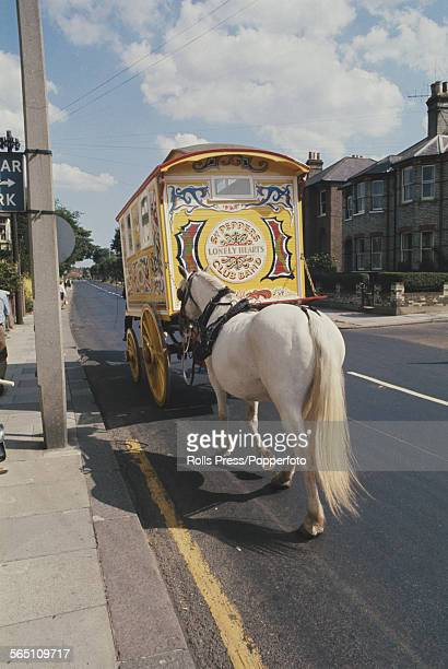 View of a mulit coloured gypsy caravan known as the 'Beatle's Yellow Caravan' bought by John Lennon of The Beatles as a present for his son Julian...