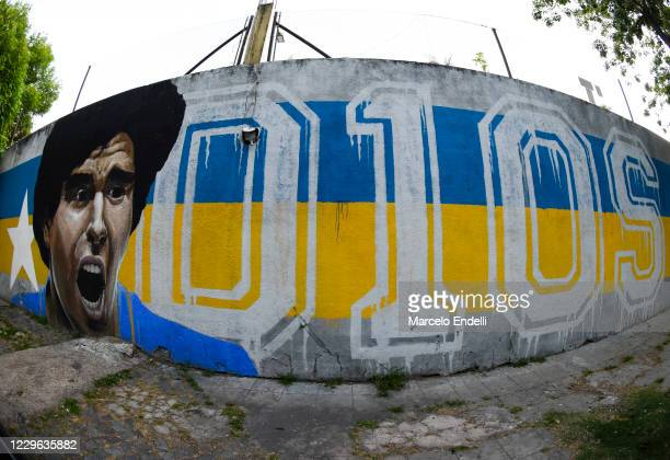 View of a mural dedicated to Diego Maradona in the surroundings of the Alberto J Armando Stadium before a match between Boca Juniors and Talleres as...