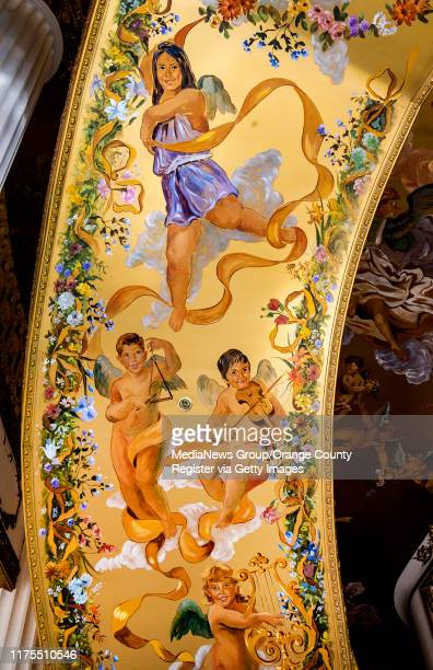 View of a mural on the underside of the stairway in the lobby of the former Trinity Broadcasting Network building located on Bear Street and the 405...