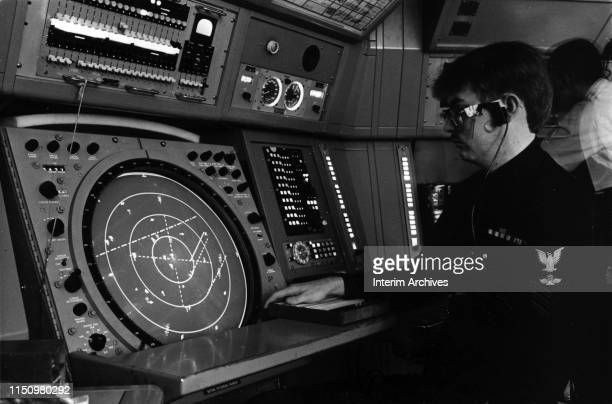 View of a Navy air traffic controller as he monitor a radar console at Naval Station Norfolk Chambers Field Norfolk Virginia January 17 1984