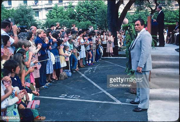 View of a onlookers and a Secret Service officer as American politician and US President Jimmy Carter addresses the crowd during a State Visit Rome...