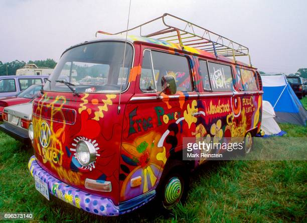 View of a painted VW bus 'Frog Power' parked in front of several tents during the Woodstock '94 music festival at Winston Farms Saugerties New York...