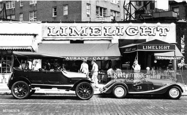 View of a pair of classic cars parked in front of the Limelight Coffee House during the seventh annual Village Voice Auto Rallye New York New York...