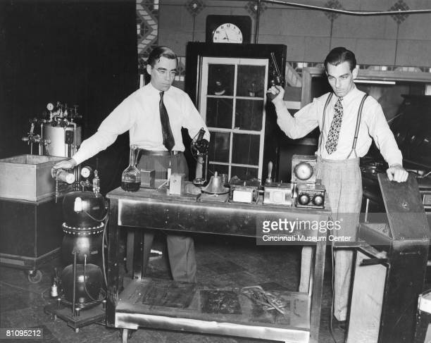View of a pair of foley artists from the sound effects department of WLW radio station as they stand at the ready to provide background effects for a...