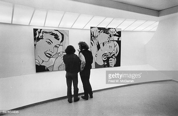 View of a pair of people at a Roy Lichtenstein exhibition at the Guggenheim Museum New York New York September 18 1970