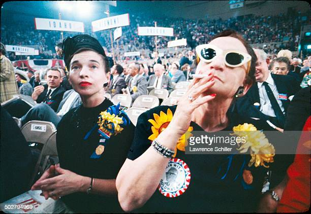 View of a pair of unidentified delegates at the 1964 Republican National Convention at the Cow Palace San Francisco California July 13 to 16 1964