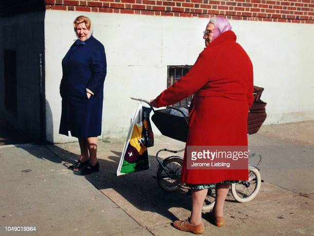 View of a pair of unidentified elderly woman one with a baby stroller on a street corner in Brooklyn's Brighton Beach neighborhood New York New York...
