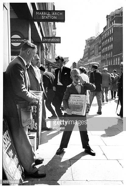A view of a paper boy selling newspapers in London England
