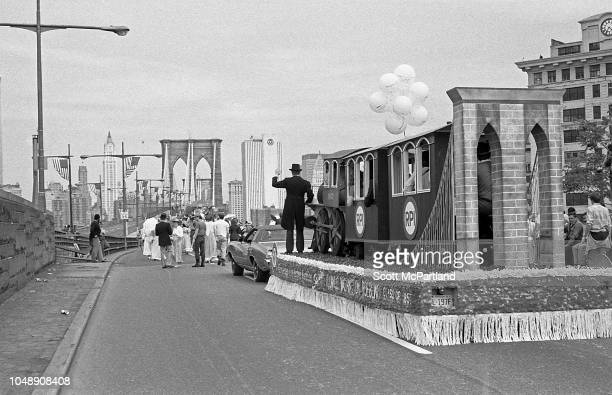 View of a parade float and marchers as they make their way across the Brooklyn Bridge during its 100th birthday celebrations in Brooklyn New York New...
