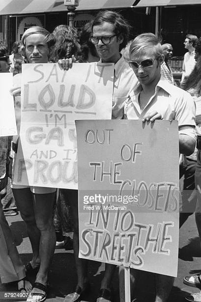 View of a paradegoers who hold signs during the second annual Stonewall anniversary march then known as Gay Liberation Day New York New York June 27...