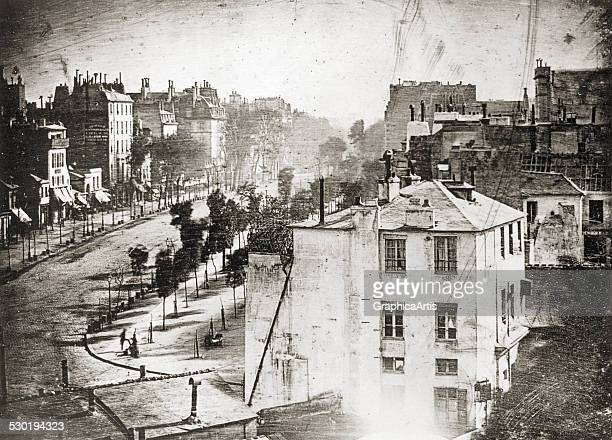 View of a Paris street entitled 'Boulevard du Temple Paris 8 in the morning' a daguerreotype by LouisJacquesMande Daguerre believed to be the...